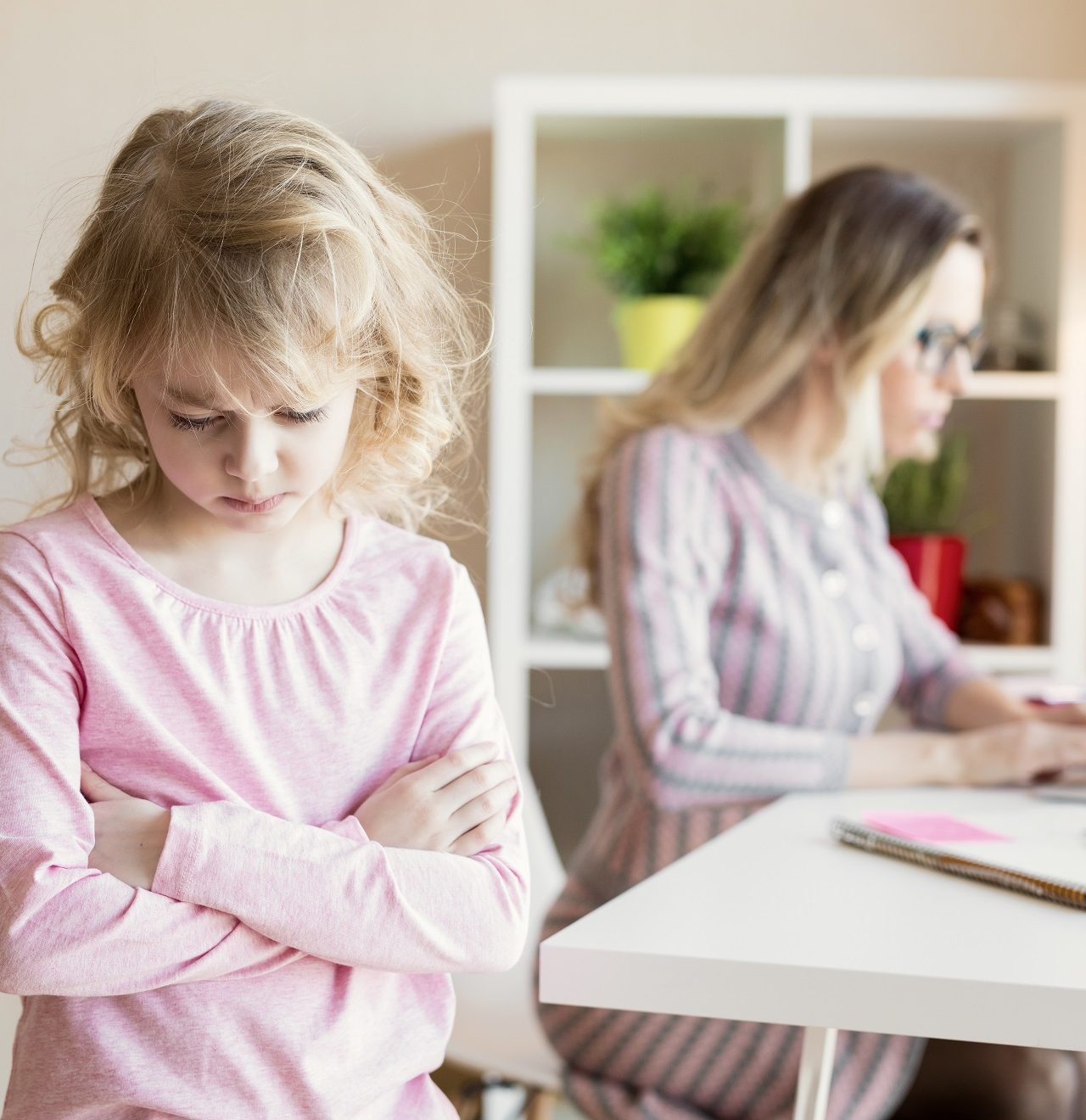 Harmful parenting practices. Sad little girl and angry mom