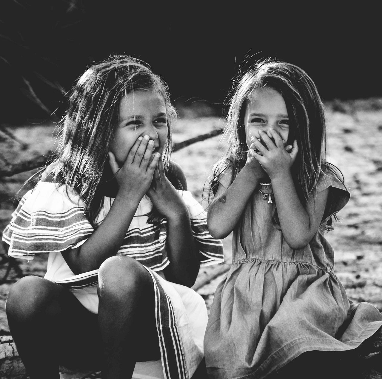 Two girls laughing: How to not spoil a child